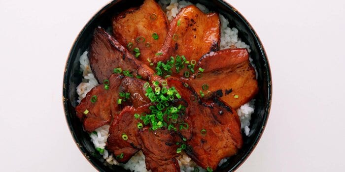 Grilled Japanese Pork Belly on a bowl of rice.
