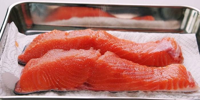 Salt curing salmon.