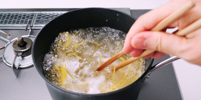 Boiling spaghetti in salted water for making Napolitan.