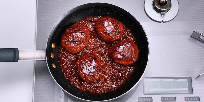 Glazing Hamburg Steak with Teriyaki sauce.