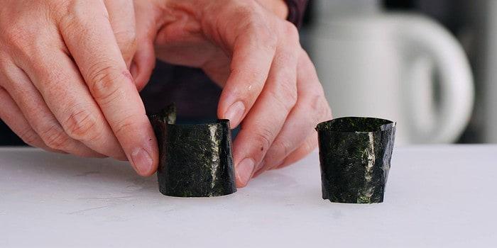 Wrapping sushi rice with nori for Gunkan roll.