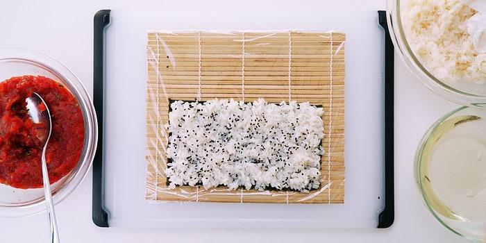 Rice sprinkled with black sesame seeds.