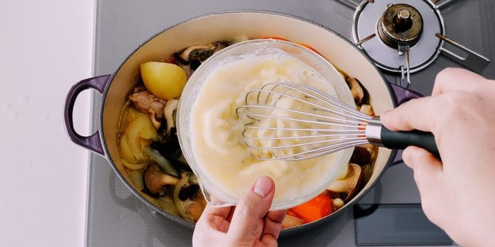 Tempering white roux for cream stew.