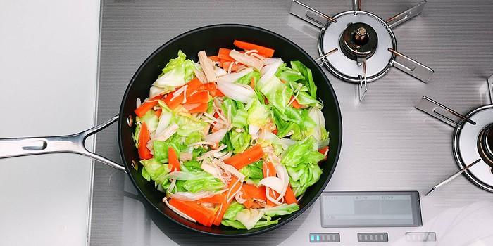 Sauteed cabbage, carrots, onions and enoki mushrooms.