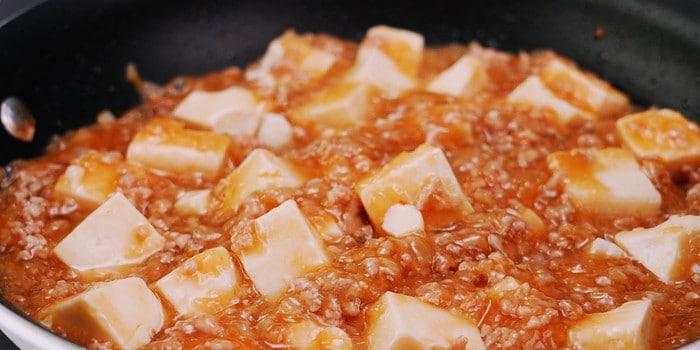 Japanese-style mapo tofu in frying pan.