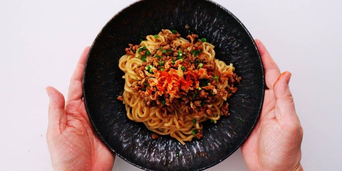 Spicy Tantanmen Ramen topped with ground pork, scallions and chili powder.