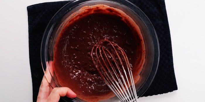 Chocolate mochi mixture after being partially cooked in the microwave oven.