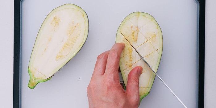 Scoring eggplant halves for Nasu Dengaku.