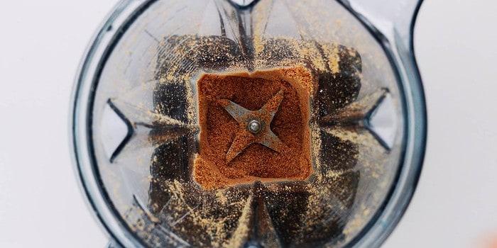 Grinding sesame seeds in a blender.