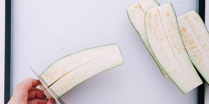 Score the eggplant to make it look like unagi.