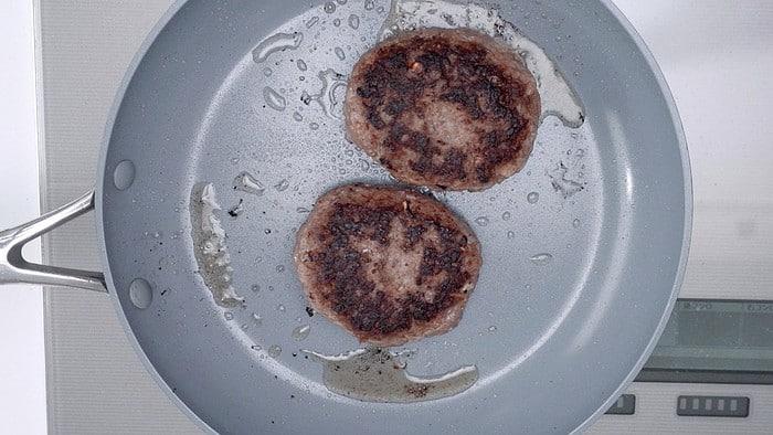 Frying burger patties for Loco Moco.