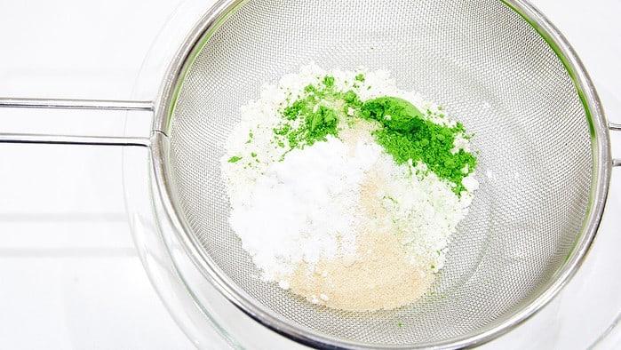 Sifting ingredients for Matcha Pancakes