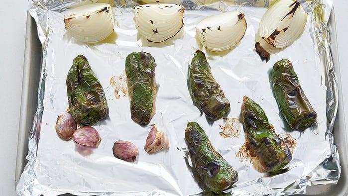 Charred aromatics for fava bean chili.