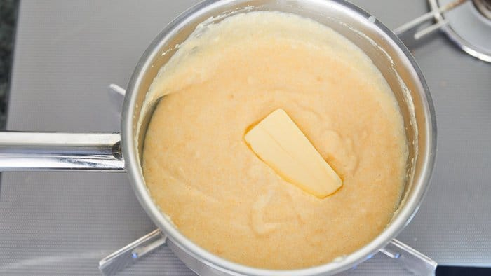 A pat of butter added to grits at the end makes them ultra-creamy.