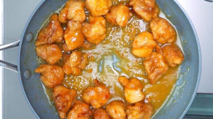 Orange chicken in a frying pan.