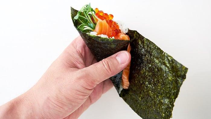 Wrap the nori around to make a cone to finish your temaki sushi.