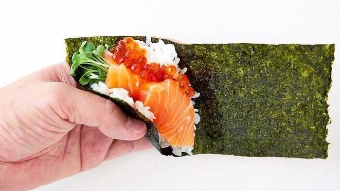 Start rolling your temaki sushi from the bottom left corner.