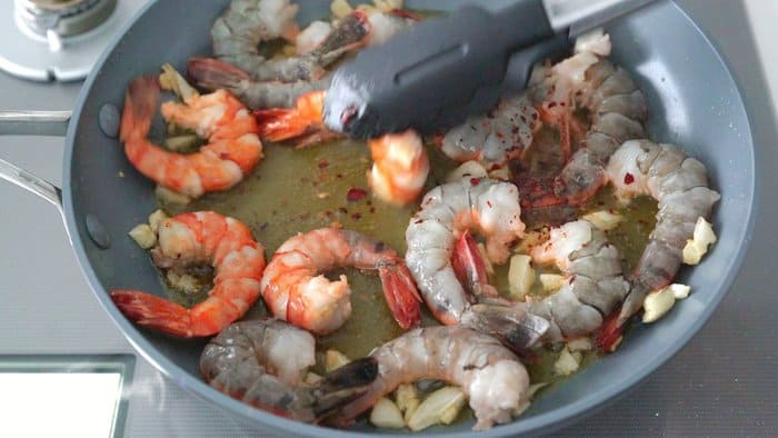 Making the best Gambas al Ajillo with shrimp, olive oil and garlic.