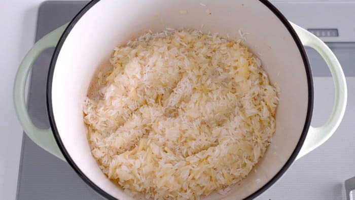 Rice added to pot and sautéed with onions and ginger.