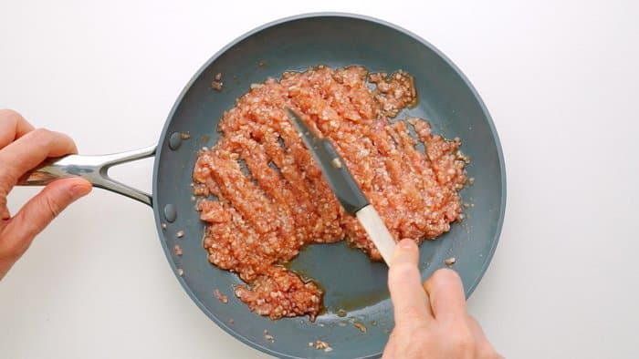 Breaking up ground chicken with a spatula for Soboro.