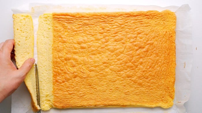 Trimming sheet cake.