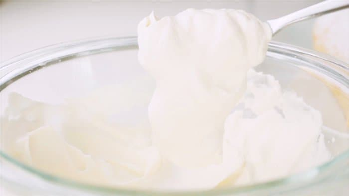 Soft whipped cream for topping the cake.
