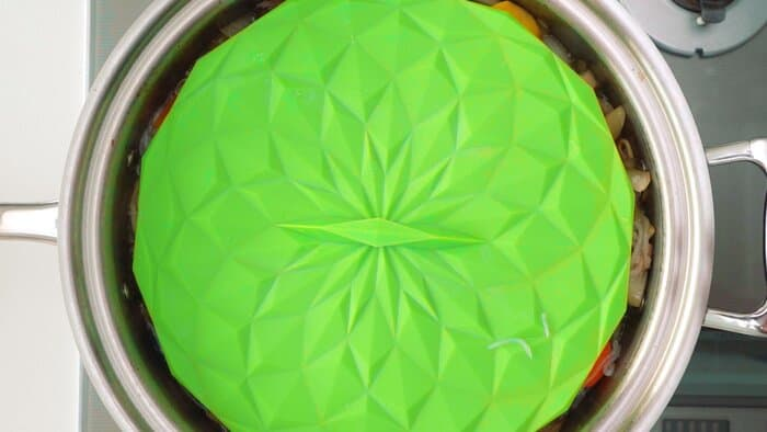 Green silicone drop lid used on top of a pot of Nikujaga.