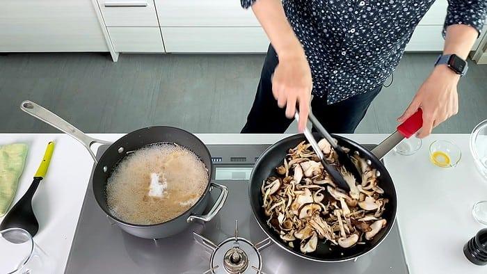 Stir-frying mixed Japanese mushrooms.