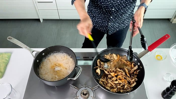 Adding soy sauce to butter and mushrooms.