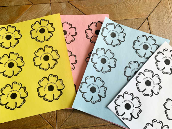 Flower images on colored construction paper ready to be cut out.