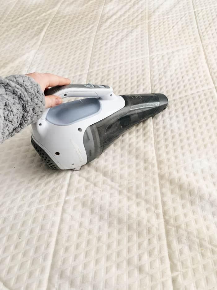 Vacuum the baking soda off the mattress.