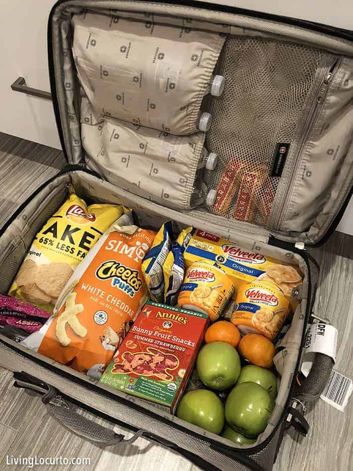 4 simpletips to save money on travel.Pack a suitcase with snacks. Get more money saving tips for Disney World, Universal Orlando and other family vacations!