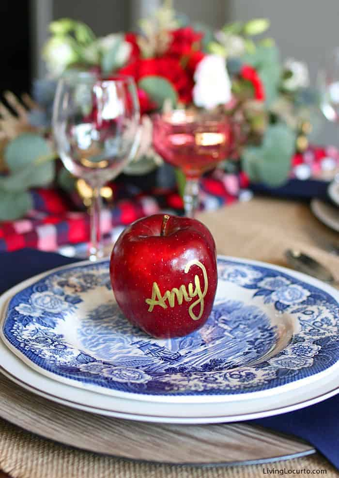 Plaid Christmas Table Decorations | Navy and Red Elegant Blue Plates Holiday Table Setting with Apple place card. LivingLocurto.com