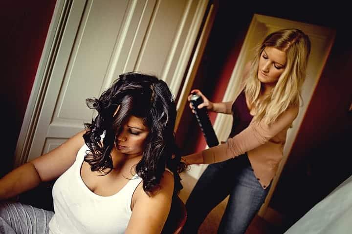 Bride having her hair done for wedding