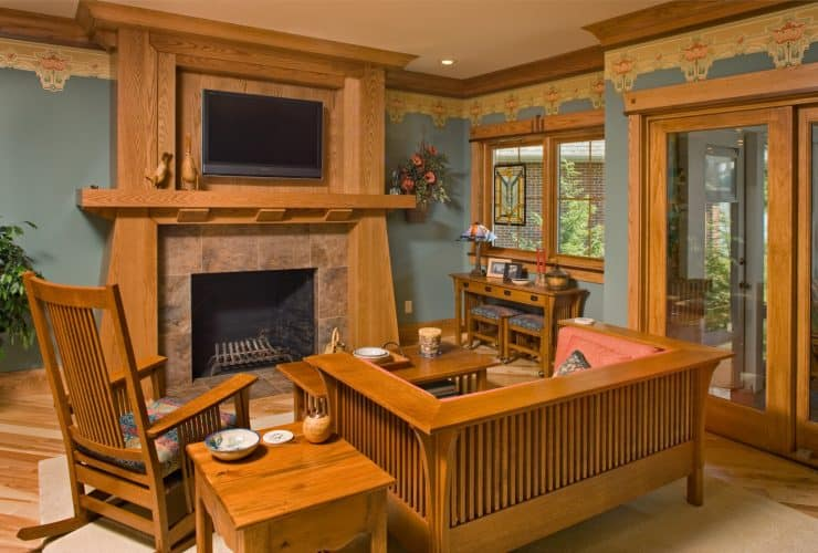 a craftsman family room with crown molding connected to the fireplace overmantel