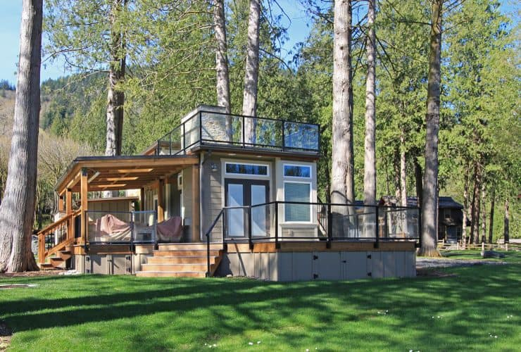 the tiny craftsman house with decks and roof extensions