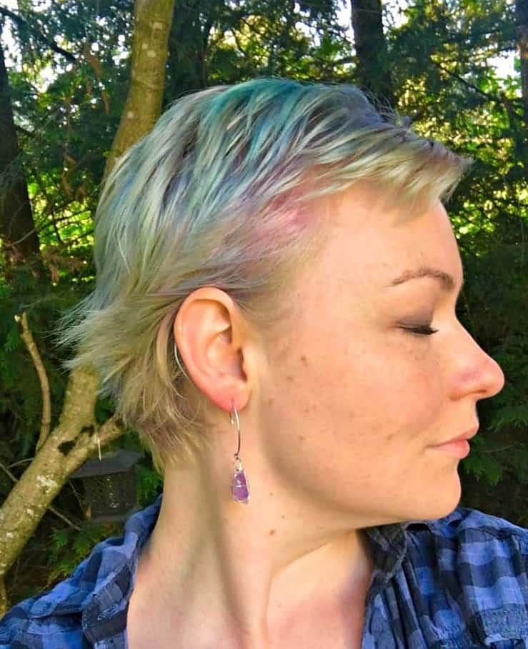 mermaid hair dye. Profile shot of blue purple and green hair