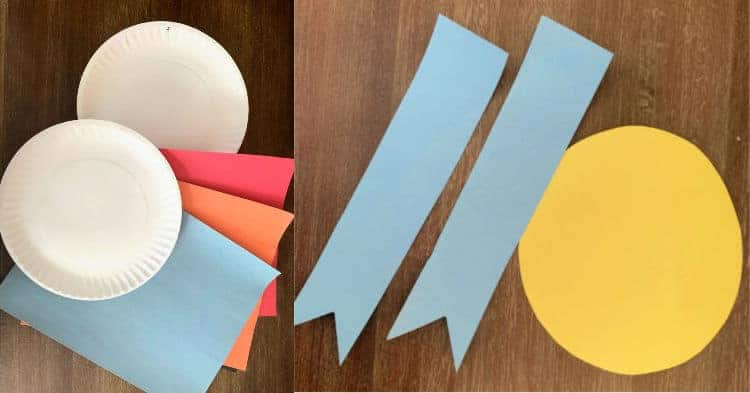supplies for paper plate awards on wood table