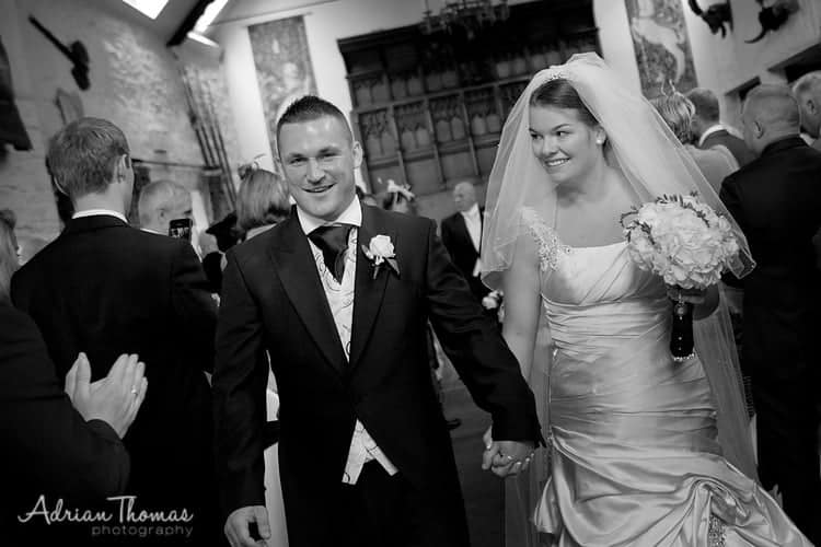Bride and groom walking down aisle after service