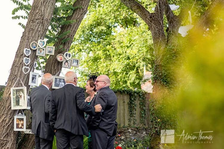 Guests viewing family tree at wedding.