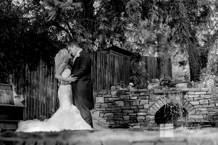 Image of wedding couple in field on family grounds next door to Llanilid Church.