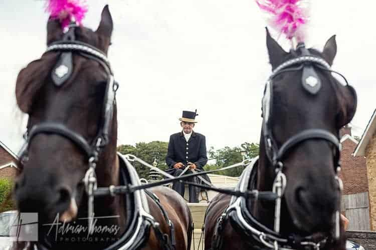 Horse and carriage ready to collect bride.