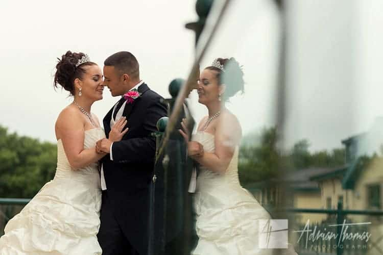 Vale Resort l wedding reception photograph of bride and groom kissing