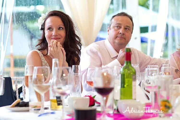 Bride listens to groom speech