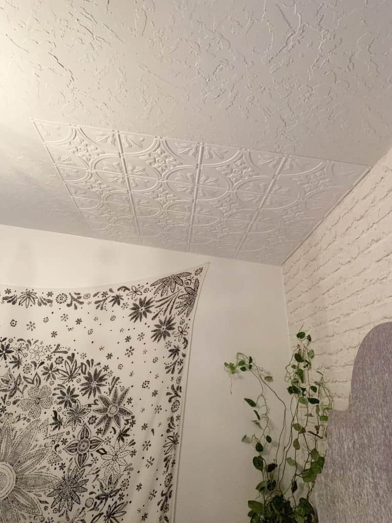 before and after of textured ceiling and ceiling panels