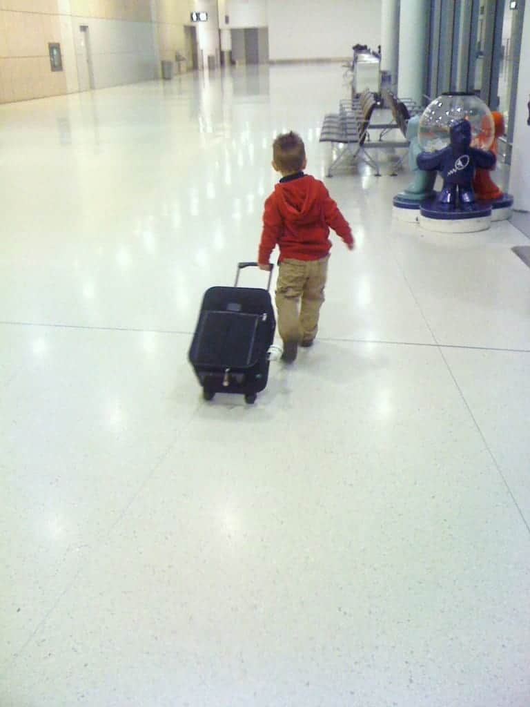 toddler, airport, suitcase, family travel, travel with toddler, traveling toddlers
