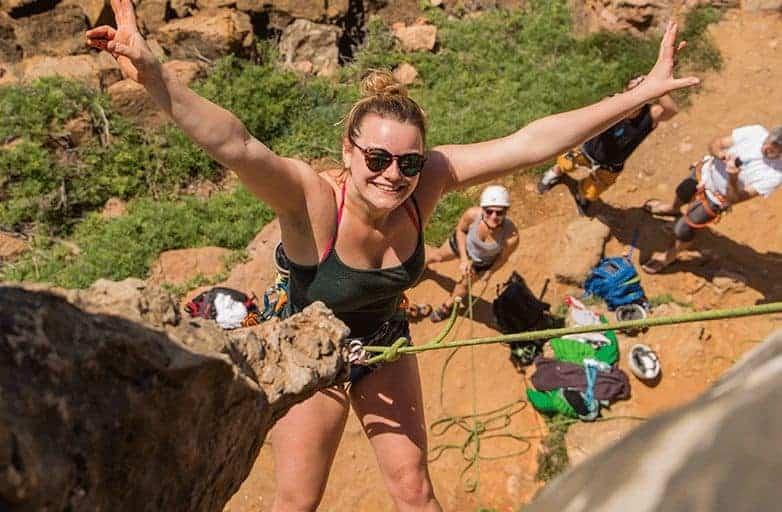 happy women rock climbing