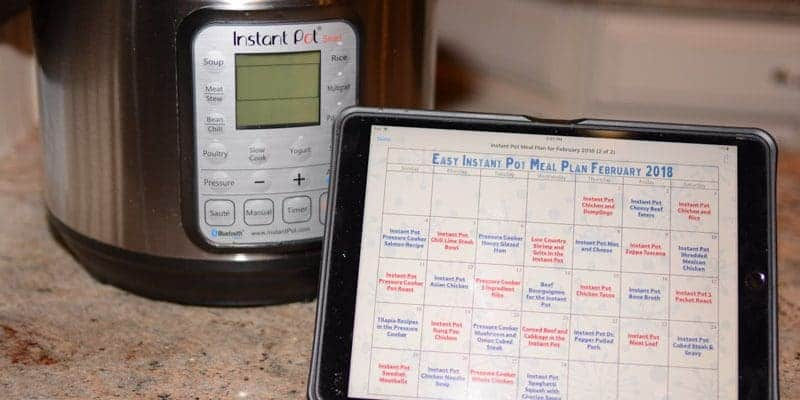 """Easy Instant Pot Meal Plan on Calendar displayed on iPad Pro 10.6"""" in front of Instant Pot for easy viewing"""