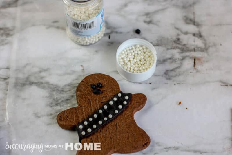 Decorating the Star Wars inspired Wookie Cookies.