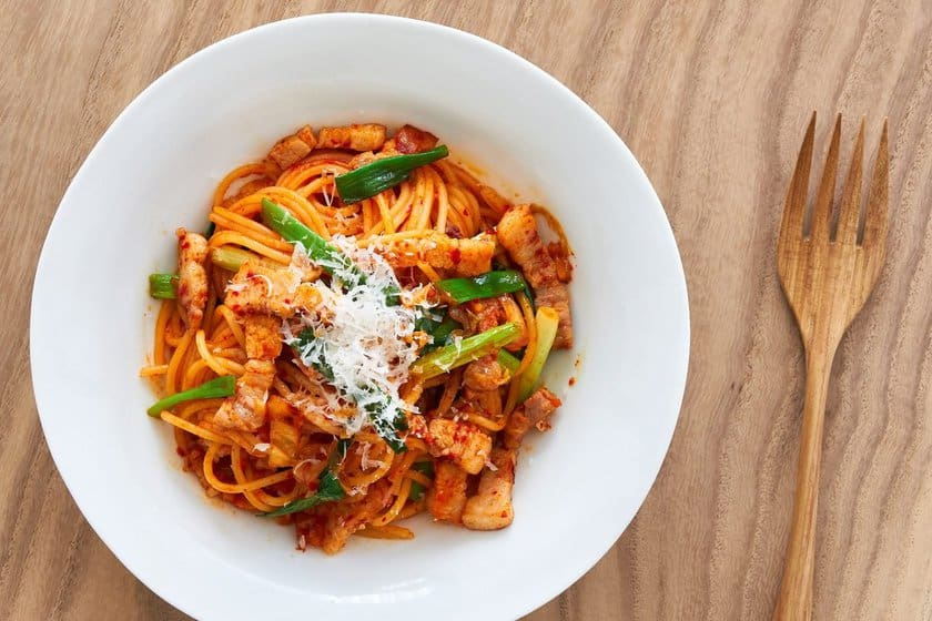 Vibrant, flavorful and spicy, this kimchi pasta is the perfect weeknight pasta coming together in under 10 minutes.